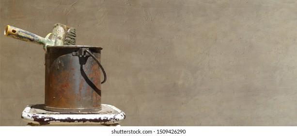 Paint bucket in rusty metal with large brushon brown banniere background