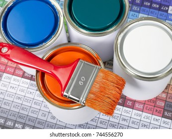 Paint can, paint brush and color swatch