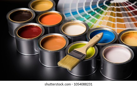 Paint can and paintbrush - Shutterstock ID 1054088231