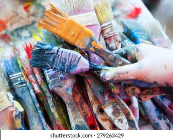 Paint cans color palette. Brushes in hand.