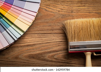 Paint colour palette and a brush in close-up.