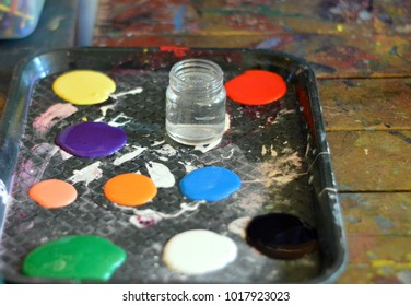 paint and glass water supplies on tray