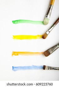 Paint line four orange yellow green blue Brushes water color on  paper