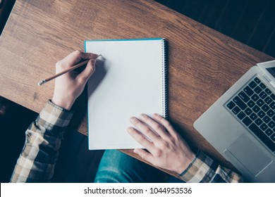 Paint painter sketch learn office workstation workplace letter notes feedback book idea report script classroom message home memo remark concept. Top view photo of left-handed man making notes in book