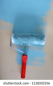 paint roller with with blue paint
