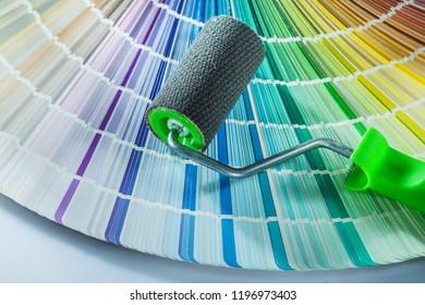 Paint roller color sampler on white background.