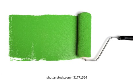 Paint roller leaving stroke of green paint over a white background