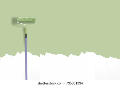 paint roller next to the green wall.