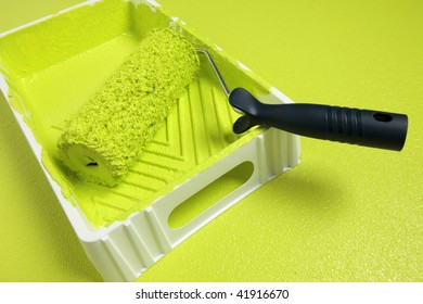 A Paint roller on same color background