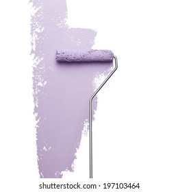 Paint roller on white wall, studio shot