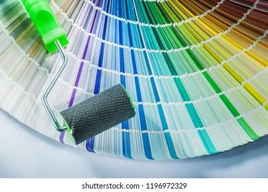 Paint roller pantone fan on white background.