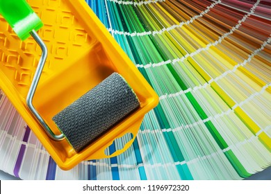Paint roller tray color sampler on white background.