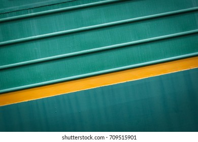 Paint smudges on the surface. The green background. Painted metal surface. The surface of the train as a background element. Metal painted green. Diagonal parallel lines