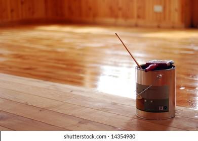 Paint tin on waxed floor