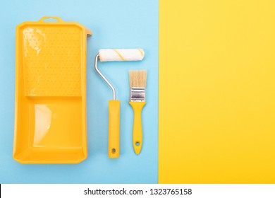 Paint tools. Paint brush and roller with tray for paint.