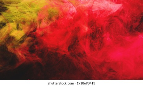 Paint in water. Colorful background. Glowing smoke cloud texture. Fire flames. Vibrant red orange yellow pink glitter vapor wave with abstract sparks on dark.