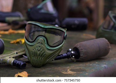Paintball Equipment Placed On Wooden Background