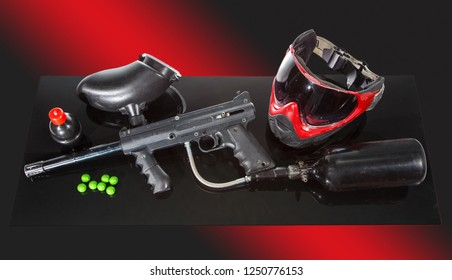 Paintball game equipment kit. Marker, mask, balls, grenade with paint.