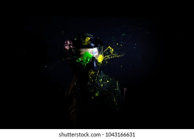 Paintball Mask zoomed in on.Splashes after direct hit to protecting mask in the paintball game.the photo as a paintball sphere is broken off at blow about a helmet.direct hit (paintball game)
