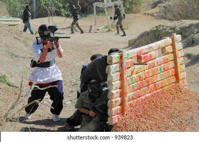 Paintball Players Shooting