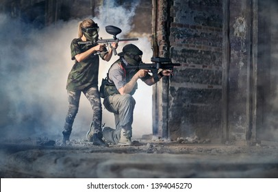 Paintball Team surrounded with smoke, indoor