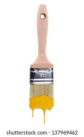 Paintbrush with dripping yellow paint isolated over white background