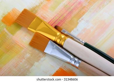 Paintbrush on painted background.