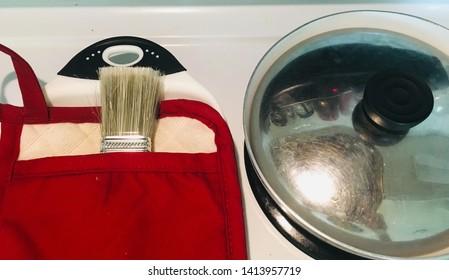 Paintbrush in oven mitt, eat sleep breathe painting