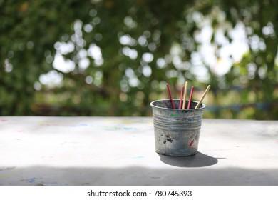 paintbrush in the steel bin