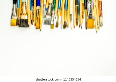 Paintbrushes and Colored Pencils Top Border