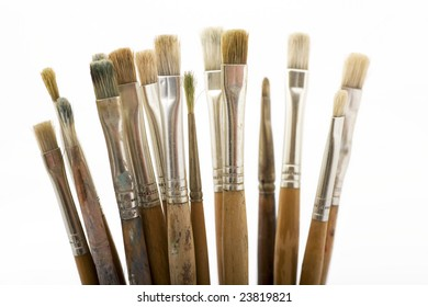 Paintbrushes in a jar on a white background