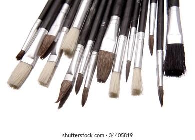 Paintbrushes over white