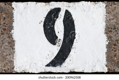 Painted abstract black number on painted white concrete background
