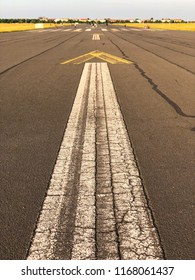 Painted arrow sign on the asphalt of the old runway at Tempelhofer Feld in Berlin, Germany in summer 2018.