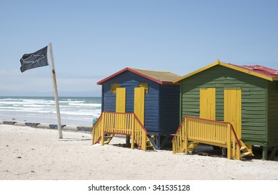 PAINTED BEACH HUTS AT MUIZENBERG SEASIDE RESORT SOUTH AFRICA - OCTOBER 2015 - Colourful beach huts at Muizenberg seaside resort near Cape Town South Africa