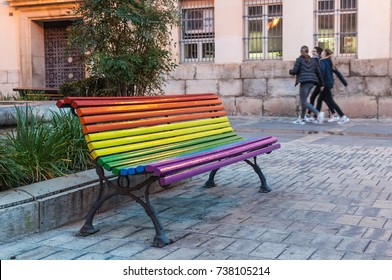 painted bench with gay flag