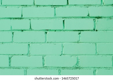 Painted brick wall texture for background. Mint pastel shade of green colour trend of the year 2020.