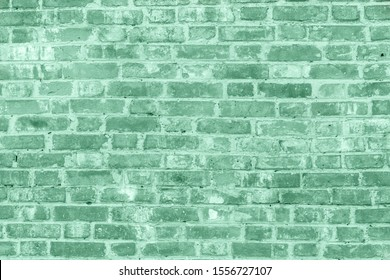 Painted brick wall texture for background. Neo mint pastel green color of the year 2020