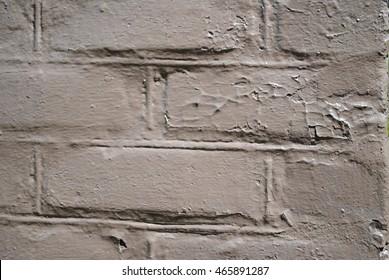 Painted brown brick wall