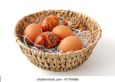 Painted and brown unpainted Easter eggs in the basket