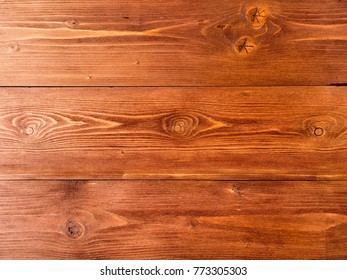 painted in brown, wood background from pine boards, contrasting the structure of the tree with knots