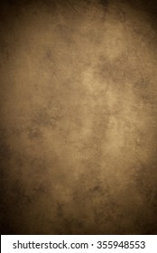 Painted canvas or muslin fabric cloth studio backdrop or background, suitable for use with portraits, products and concepts. Medium brown with warm tones.