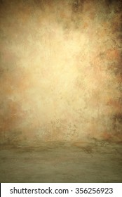 Painted canvas or muslin fabric cloth studio backdrop or background, suitable for use with portraits, products and concepts. Pink, peach, olive green, brown and ecru colors with lighter center spot.