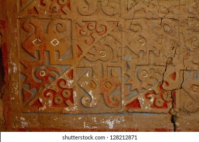 Painted and carved adobe wall in Huaca de la Luna, archaeological site in the Moche valley, Peru