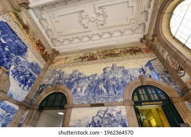 Painted ceramic tileworks on the walls of Main hall of Sao Bento Railway Station in Porto. The building of station is a popular tourist attraction of Europe