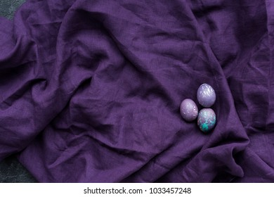 Painted chicken eggs on textile background