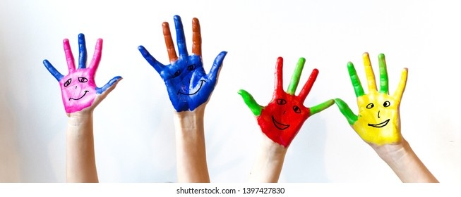 painted children's hands with smileys background panorama white isolated