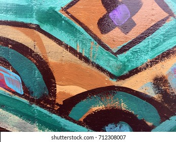 Painted colorful tribal pattern on wood texture for interesting backgrounds.