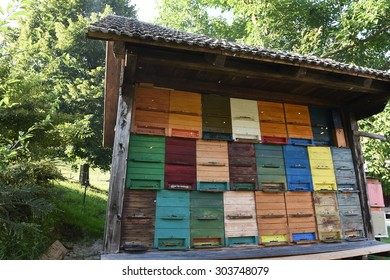 Painted colourful wooden beehive, isolated. Close-up. Honey. Bees. Traditional. Apiary. Beekeeping. Apiology. Farming. Carniolan honey bee. Apis melifera carnica. Slovenia.