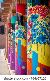 Painted columns in the downtown plaza in Santa Fe New Mexico.